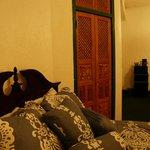Comfortable new bedding, carved wooden doors