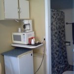 Microwave,coffee pot and frig.