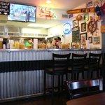 Inside of restaurant---open kitchen behind bar.