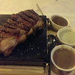 Sirloin steak, cooked at the table.