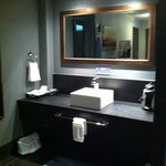 Stylish but dark vanity area - good counter space though
