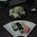 Avocado and salmon sushi and scallops salad