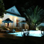 villa baan rim haad at night