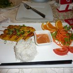 Rice with chicken skewers