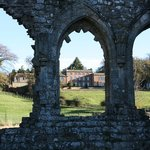 A view of Easby Hall through the Abbey