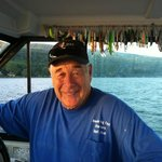 Capt. Dick at the helm