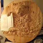 Plaque with a lion, hand carved in swiss pine wood. The plaque has been wax polished.