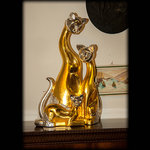 Cats, hand carved in swiss pine wood and gilded with pure gold.