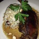 Crispy cherry duck hindquarter with cashew rice.
