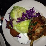 Peach pork chop with potato cakes and cabbage. $14