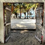 Gates to beach, hammocks and beach bar coming from dining/common area