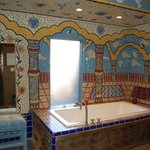 mosaic wall scene around the soaking tub
