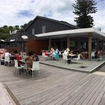 Enjoy the sun on the deck at front of Torpedo Bay Cafe