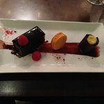 Dark chocolate mousse, coffee glazed nutty brownie with passion fruit sorbet cylinder