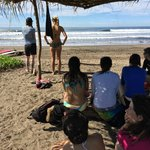 checking out the waves under the shady beach palapa