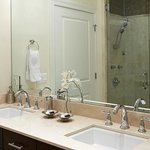 The master bathroom of each suite features two vanities.