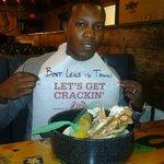 My hubby & his bucket of crabs.