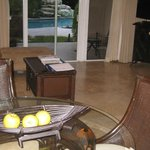 Dining and Livingroom Area with Sliding Door to Pool