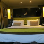 The comfortable bed in our De-luxe Room