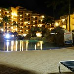 Night view of pool area and resort