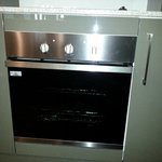 Oven and there is a dishwasher and microwave also