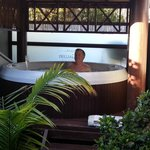 Outdoor, undercover private Balinese hot tub.