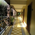 Corridor near our room (near central lobby with trees)