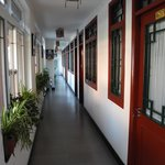 The corridor with bedroom doors facing