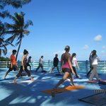 Doing Yoga and the beach platform