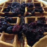 Warm Belgian waffle with hot mixed berries, honey and side of cream