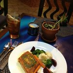 Seared Salmon entree atop parsnip puree with side of autumnal veggies