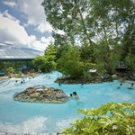Guests enjoying the outdoor Subtropical Swimming Paradise