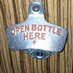 bottle opener on the end of the desk 11/13