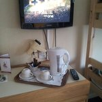 Tea tray. New kettle. Clean cups. Flat screen tv .