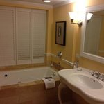 jacuzzi with shutters to the bedroom