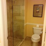 toilet with glass door shower were separate