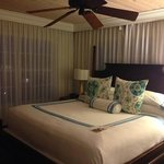 bedroom with surround windows facing ocean. room 311