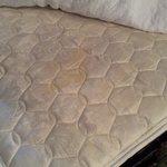 yellow stain on uncomfortable mattress