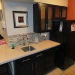 Sink and fridge in kitchen area.