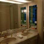 2 sinks with a large mirror