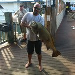 smokey with a 40lb black drum fishing on the dock on his day off