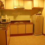 Kitchen in executive suite room