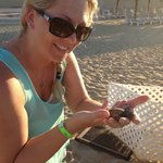 Katie holding a baby Sea Turtle