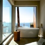 In addition to spa bathroom, freestanding tubs with sitting areas share the amazing ocean views