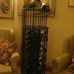 Cylindrical wrought iron wine rack in the lounge