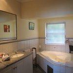 Lovely large bathroom with double basins & spa bath