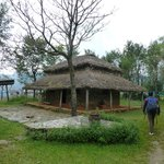 One of the reconstructed huts