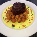Filet Mignon on top of noisiette potatoes and mustard creme sauce