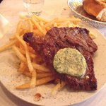Beef steak, fries and herb butter