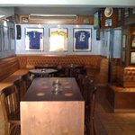 Part of the main bar with official memorabilia.